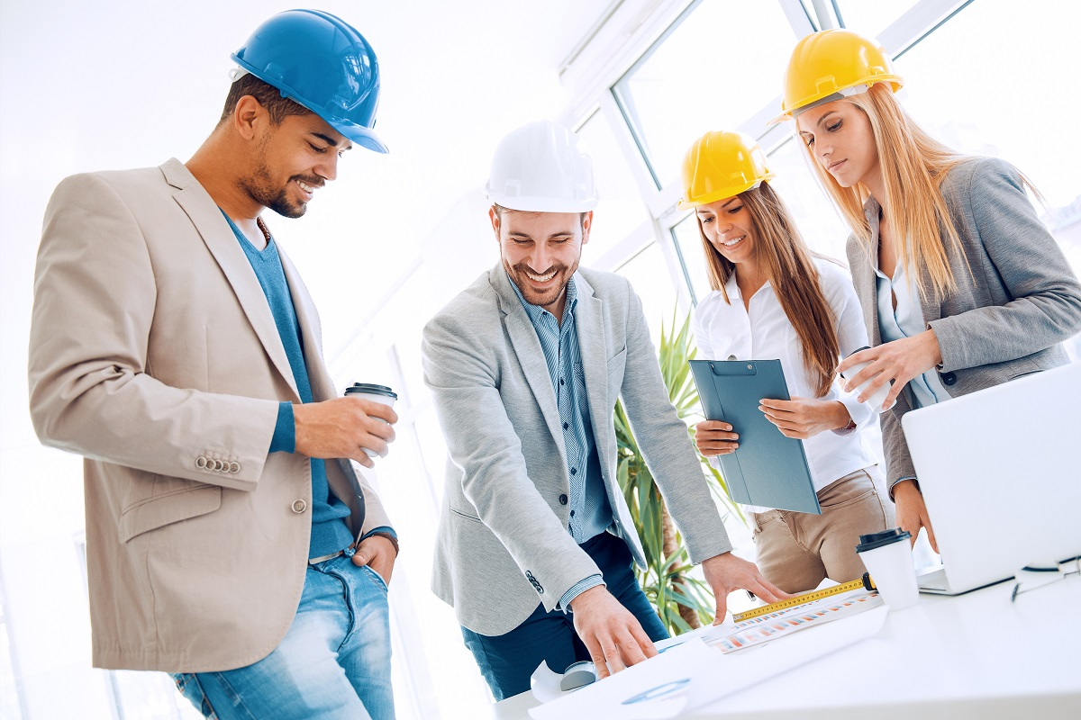 Employees wearing hard hats in site