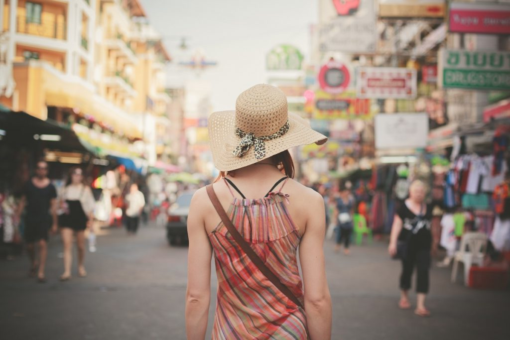 woman standing in the middle of street