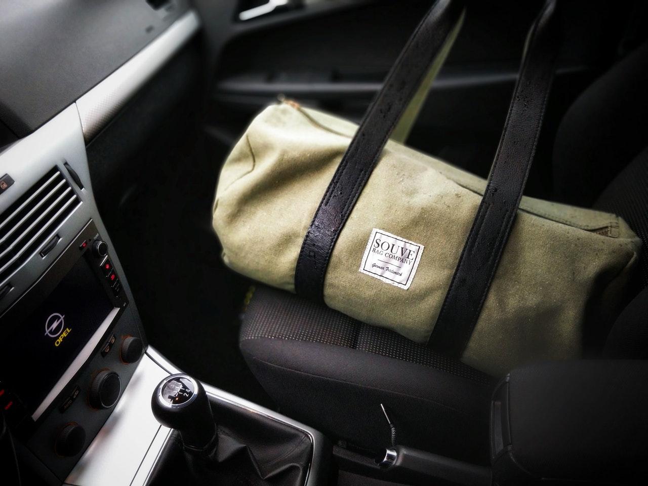 duffle bag in a car