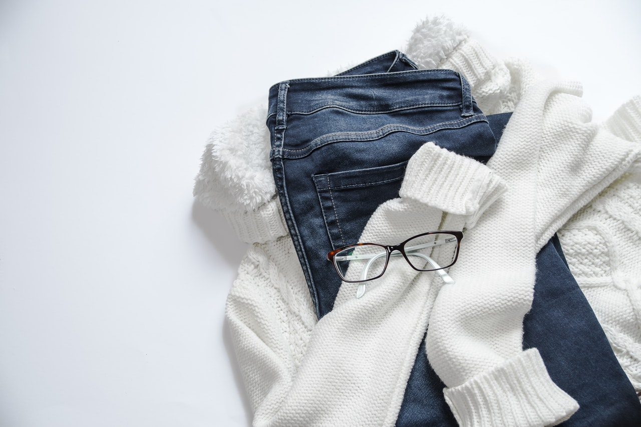 jeans sweater and glasses
