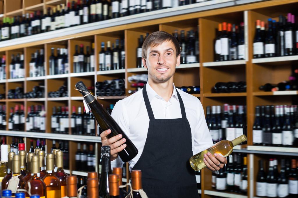 man holding wine