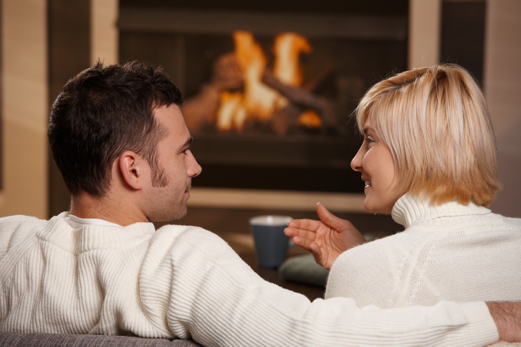 couple in front of a fireplace