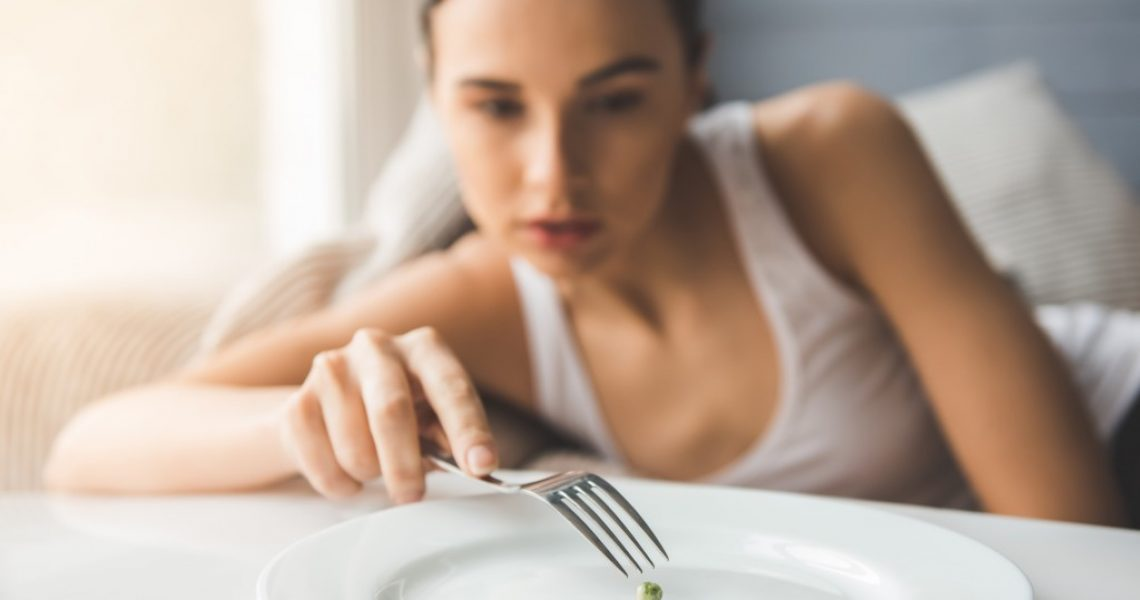 a woman with an eating disorder
