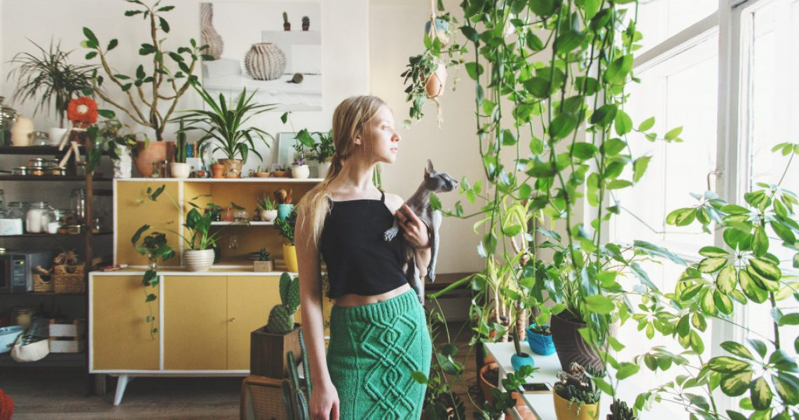 woman inside house with plants