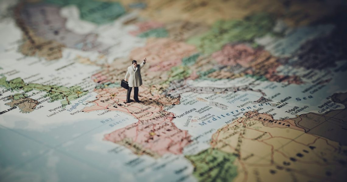 miniature model of a man on the map of europe